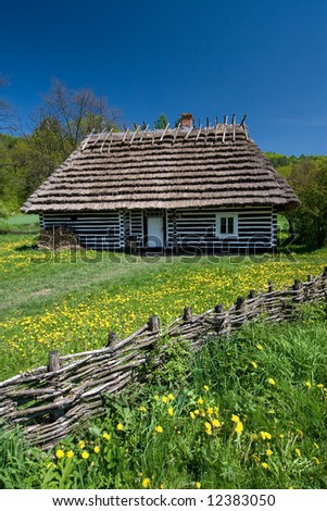 Polish old house with wooden fence in front
