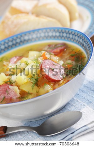Polish sauerkraut soup Kapusniak in the bowl