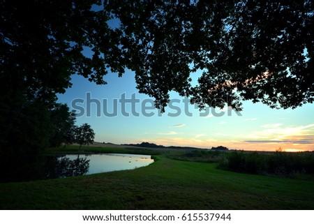 Polish village. Park with pond. Zdjęcia stock ©