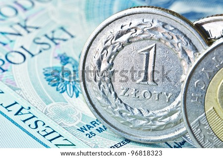 Polish zloty coins over banknote background