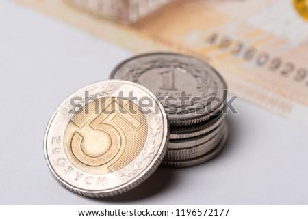 Polish zlotys on white background close up #1196572177
