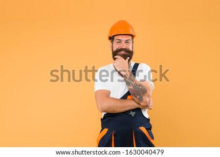 Polished approach. Craftsman keep head safe in helmet. Improvement and renovation. Brutal man builder. Engineer builder in uniform. Man builder hard hat. Handyman at workshop. Creativity and practice.