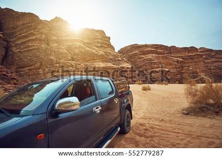 Polished big dark car in desert of Arabia  #552779287