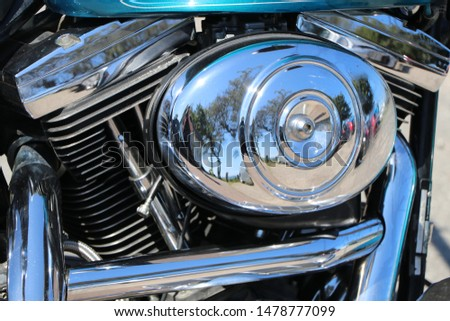 Polished chrome elements of a motorbike engine #1478777099