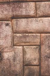 Polished dry-stone walls of Machu Picchu. Ashlar technique. Inca architectural style. April, 2018.