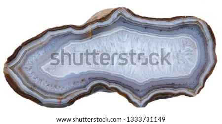 Polished specimen of banded Agate with a Quartz crystal geode center, isolated on a white background. #1333731149
