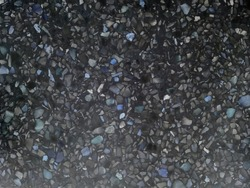 Polished stone floor surface in black color. Terrazzo flooring pattern style, beautiful glitter marble background.