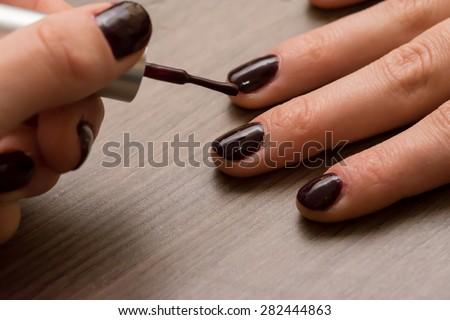 stock-photo-polishing-nails-282444863.jpg