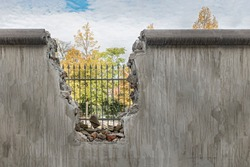 Political barricade that limits freedom Broken wall that symbolizes freedom