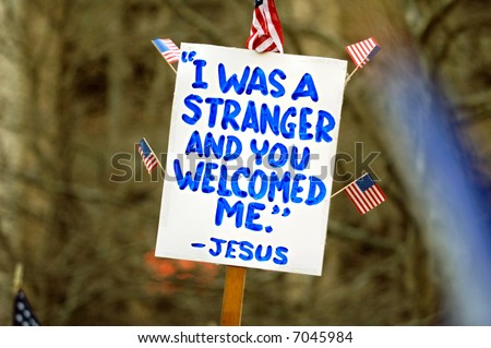 Political sign with with religious tone at a pro-immigration rally in USA