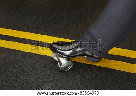 Politician's shoe stops a dented can from rolling on a road