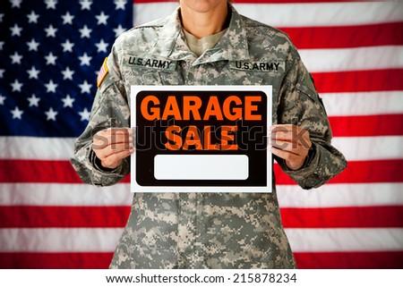 Politician: Soldier Holding Up Garage Sale Sign
