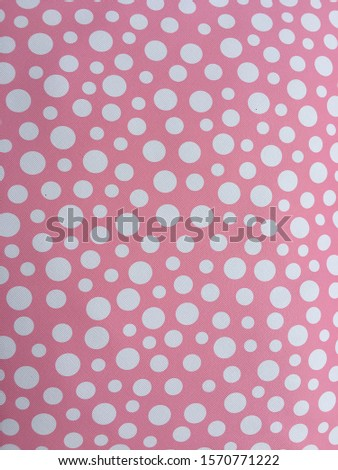 Polka dot artificial leather is used in making pillows or cushions. There are many colors of leather. The pattern on the leather is white polka dots.