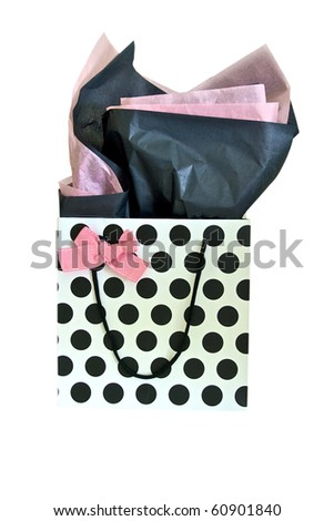 Polka dot gift bag with pink bow and pink and black tissue paper
