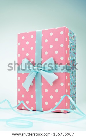 Polka dot gift box with ribbon and bow