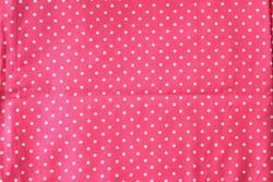 Polka dot pattern fabric texture background.