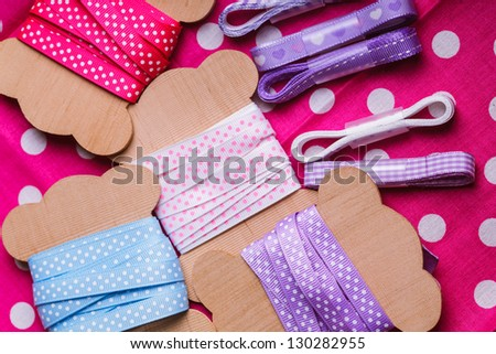 Polka dot ribbon on wooden vintage bobbins for scrapbooking