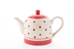 Polka dot tea pot isolated on white background