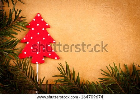 Polka dots Christmas tree decoration on old paper background.