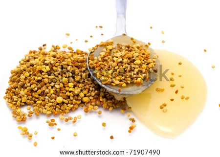 Pollen and honey in the spoon