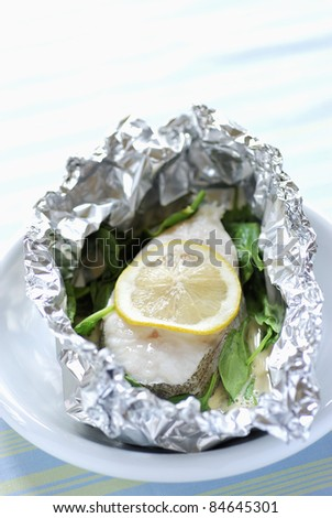Pollock and lemon cooked in aluminium foil