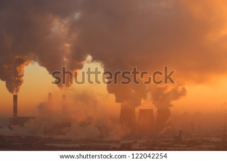 Polluting factory at dawn. also see video 3152725
