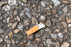 Pollution by cigarette stub thrown on the ground