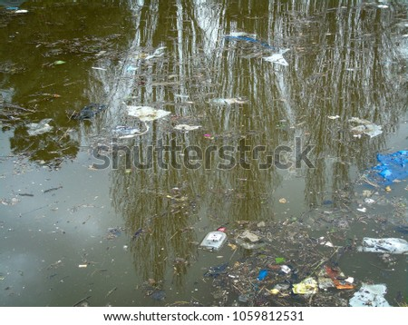 Pollution on the Grand Union Canal in London area, showing the garbage that floats on the canal