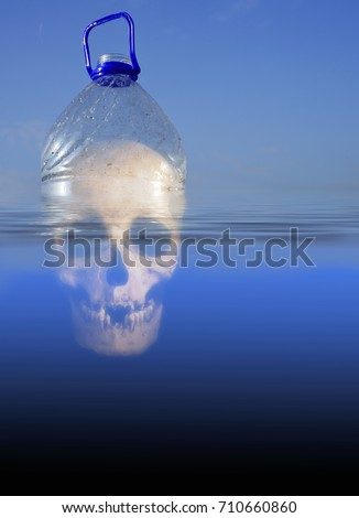 Pollution themed design of a plastic PET drinking container floating in sea water with a human skull submerged beneath the environment #710660860