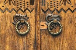 Poltava, Ukraine - April 14, 2021: beautiful wooden door with a carved floral pattern in the Ukrainianhistorical building in the Ukrainian Art Nouveau style. Museum of Local Lore in Poltava, Ukraine