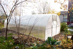polycarbonate greenhouse in the garden near the country house