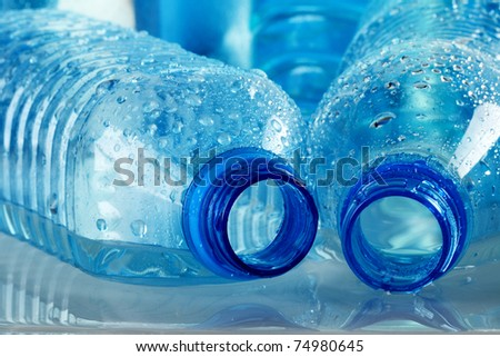 Polycarbonate plastic bottle of mineral water isolated on white background