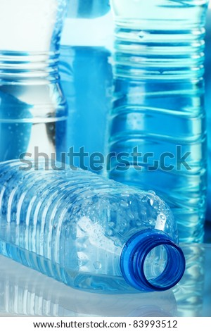 Polycarbonate plastic bottles of mineral water - stock photo
