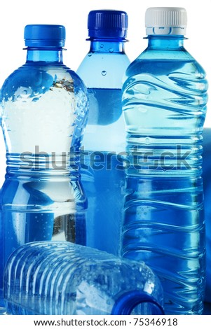 Polycarbonate plastic bottles of mineral water on white background