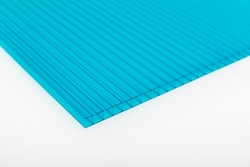 Polycarbonate plastic sheet panel image. PC hollow sheet for translucent roofing close up. Single turquoise (greenish-blue) color on white background