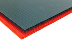 Polycarbonate plastic sheets panels images. PC hollow sheet for translucent roofing. Red and green color sheets on white background