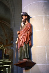 Polychrome wooden statue representing Saint James the Greater dressed in a pilgrim's costume, with hat, cape, staff and pumpkin