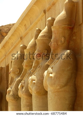 Polychromed statues of Queen Hatshepsut (1508-1458 BC) at the awesome Temple of Hatshepsut, between the Valley of Kings and the Valley of Queens, in Luxor (Ancient Thebes), Egypt.