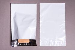 polyethylene envelope on grey background