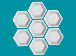 Polygon of hexagons. White plastic hexagonal weighing trays on aegean teal background