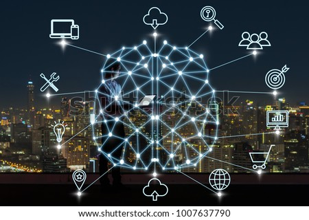Polygonal brain shape of an artificial intelligence with various icon of smart city Internet of Things Technology over businessman using laptop with cityscape background, AI and business IOT concept