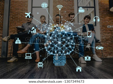 Polygonal brain shape of an artificial intelligence with various icon of smart city Internet of Things Technology over Group Of Asian and Multiethnic people using the technology device in working loft