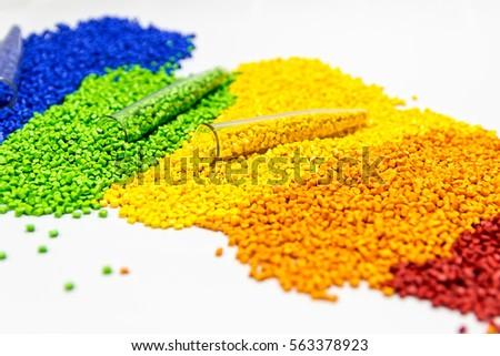Polymeric dye. Plastic pellets. Colorant for plastics. Pigment in the granules. Foto stock ©
