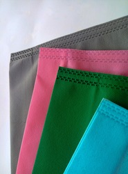 Polypropylene carry bag. four pieces of polypropylene tote bag in gray, pink, green, blue color on a white background