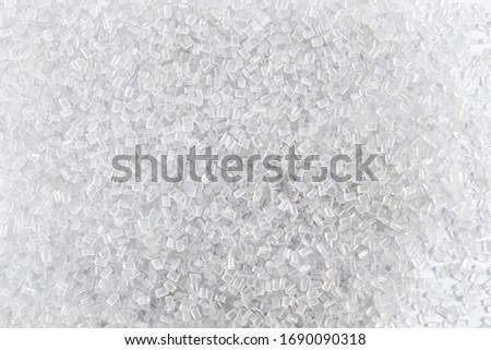 Polypropylene granule close-up background texture. plastic resin ( Masterbatch).Grey chemical granules for industrial plastic production