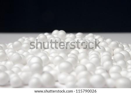 Polystyrene foam beads. Polystyrene foam texture, Polystyrene foam and black background, Free space