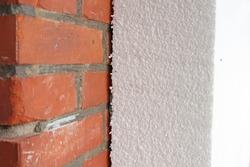 polystyrene insulation panel on brick wall