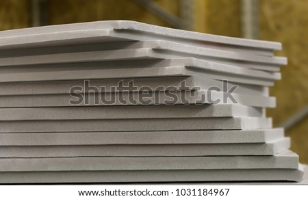 polystyrene slabs lie a tower close-up of gray color. heat insulation for home #1031184967