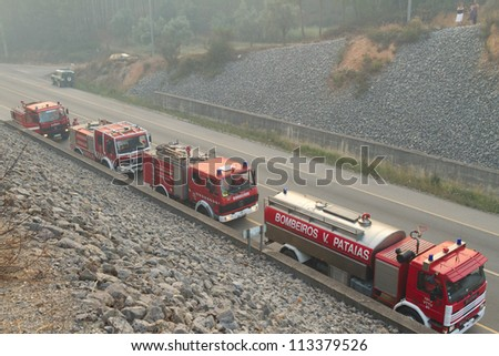 POMBAL, PORTUGAL - JULY 15: Fire Trucks on a road to prevent that wildfire crosses the road, in Pombal, Portugal on July 15, 2012