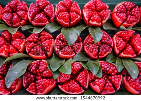 Pomegranate, a several-celled reddish berry that is about the size of an orange with a thick leathery skin and many seeds with pulpy crimson arils of tart flavor.